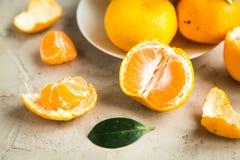 Свежие tangerines на таблице Стоковая Фотография RF