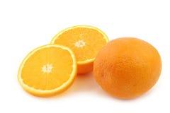 Свежий апельсин и некоторые отрезали части Стоковое Изображение