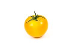 Свежий желтый томат на белой предпосылке Стоковые Изображения RF