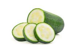 Свежий зеленый цукини при кусок изолированный на белизне Стоковое Изображение