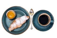 Свежий круассан с чашкой горячих кофе и меда для завтрака Стоковая Фотография