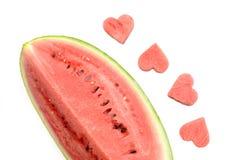 Свежий кусок арбуза с высекаенными сердцами на белой предпосылке Стоковые Фото