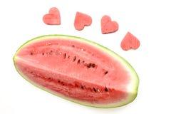 Свежий кусок арбуза с высекаенными сердцами на белой предпосылке Стоковые Изображения RF