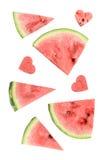 Свежий кусок арбуза с высекаенными сердцами на белой предпосылке Стоковое Фото