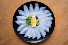 Свежий сырцовый сасими кальмара на плите Стоковое фото RF