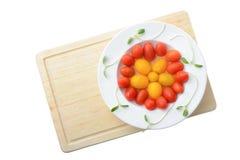 Свежий томат сливы вишни на белой плите изолированной на белизне, Healt Стоковые Фото
