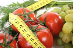 Свежий фрукт и овощ в ленте измерения Стоковая Фотография