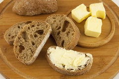 Свежий хлеб и масло Стоковая Фотография