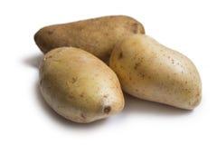 3 свежих картошки изолированной на белой предпосылке Стоковое Изображение