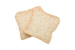 2 свежих куска хлеба всех пшеницы изолированного на белизне Стоковое Изображение