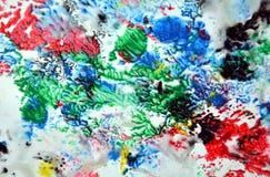 Сверкная красные зеленые голубые розовые цвета и оттенки Абстрактная влажная предпосылка краски Пятна картины стоковые фото