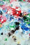 Сверкная красные зеленые черные серые голубые розовые цвета и оттенки Абстрактная влажная предпосылка краски Пятна картины стоковые фотографии rf
