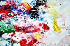 Сверкная черные красные цвета и оттенки желтого зеленого цвета голубые мягкие Абстрактная влажная предпосылка краски Пятна картин стоковые фото