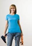 сверло держа самодостаточную женщину Стоковое Изображение RF