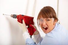 сверля женщина отверстия кричащая Стоковое Изображение RF
