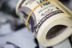 Сверните 100 долларовых банкнот Американская банкнота денег Стоковые Изображения RF