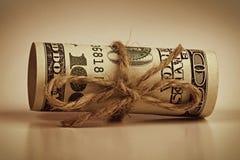 Свернуто-вверх 100 кредиткам доллара Стоковые Изображения