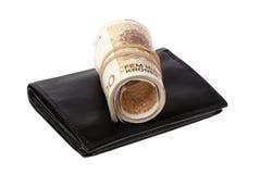 Свернутые банкноты на бумажнике Стоковые Фото