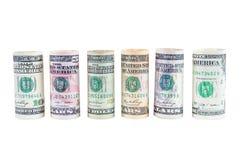 Свернутые банкноты доллара на белой предпосылке Стоковое фото RF