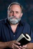 свернутый проповедник удерживания библии Стоковое Изображение