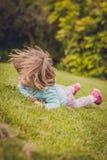 Свертывать вниз на траве Стоковые Фото