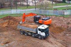 Сверхмощное машинное оборудование в строительной площадке для нового жилого дома в Германии Стоковые Изображения