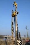 Сверля машина на строительной площадке Стоковые Фотографии RF