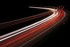 Света автомобилей с ночью стоковое фото