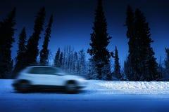 Света автомобиля и дороги зимы Стоковое Изображение