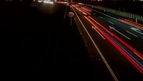 Света в шоссе, петл-готовый промежуток времени быстрого автомобиля сток-видео
