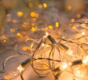 Света гирлянды золота Стоковая Фотография