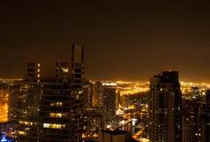 Света города освещают ночное небо Стоковая Фотография