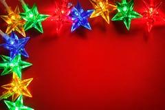 света изображения рождества шариков предпосылки defocused Стоковое Фото