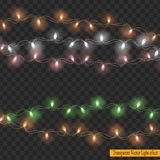 Света рождества изолированные на прозрачной предпосылке Стоковое фото RF