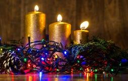 Света рождества и свеча золота Стоковые Изображения