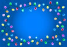 Света рождества на голубой предпосылке с космосом для текста Стоковая Фотография RF