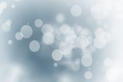 Света рождества на голубой предпосылке стоковое изображение rf