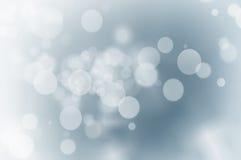 Света рождества на голубой предпосылке стоковые изображения rf