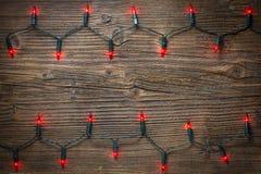 Света рождества на деревянном столе Стоковое Фото