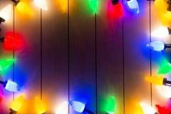 Света рождества на деревянном Стоковое фото RF