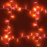 Света рождества на красной предпосылке, яркие света Стоковое Изображение RF