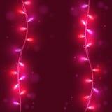 Света рождества на розовой предпосылке, яркие света, Стоковые Изображения