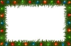 Света рождества с границей сосенки Стоковая Фотография