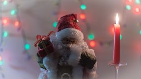 Света свечи подарков рождества Санта Клауса Стоковое Фото