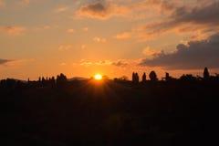 Света солнца заход солнца florence Тоскана Италия Стоковое фото RF