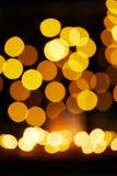 Света bokeh желтого цвета рождества defocused стоковые фотографии rf