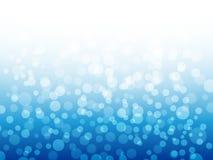 Света Bokeh на голубой предпосылке Дизайн зимы абстрактное рождество сини предпосылки также вектор иллюстрации притяжки corel Стоковые Фотографии RF