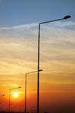 светильник вывешивает заход солнца Стоковая Фотография