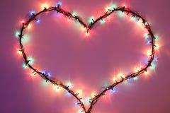 светить темного сердца предпосылки розовый Стоковое фото RF