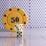 Светлая кость на предпосылке обломоков покера Стоковое Фото